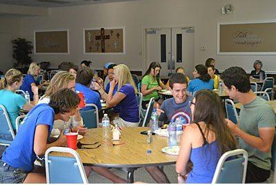 Bicyclists on the 4K for Cancer, a 4,000-mile bike ride to raise awareness, enjoy dinner at Saint John United Methodist Church. Zirconia Alleyne   Kentucky New Era